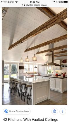 white kitchen w/ vaulted ceiling