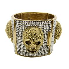 Add a funky twist to your outfit with the Butler & Wilson Swarovski Crystal Skulls on Four Square Paneled Bracelet.
