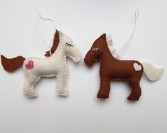 Felt horse ornament handmade felt ornaments by grabacoffee on etsy. $5.60 each, many colors to choose from.  Maybe have names embroidered?