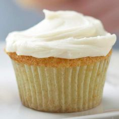 Simple White Cupcakes with Creamy Frosting - nothing beats a classic! More cupcake recipes here: http://www.bhg.com/recipes/desserts/cupcakes/our-best-cupcake-recipes/