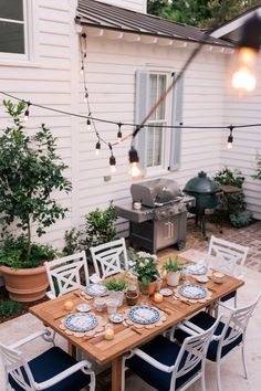 Our Back Patio Makeover Just In Time For Summer Entertaining - Gal Meets Glam - - Our Back Patio Makeover with Lowe's. Find out what Lowe's furniture and appliances we used to redo our backyard. We absolutely love the result! Cozy Backyard, Backyard Retreat, Small Backyard Landscaping, Small Patio, Backyard Ideas, Patio Ideas, Landscaping Jobs, Garden Ideas, Covered Back Patio