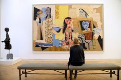 A visitor looks at a Picasso's 'Women in the bathroom' during the press day at the Picasso museum, on October 18, 2014 in Paris. The collection is displayed inside the Hotel Sale which was renovated to house the art and is located in the heart of the Marais district. AFP PHOTO/BERTRAND GUAY.