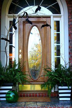 Our last-minute, non-traditional Halloween front door decorations:   http://emilyaclark.blogspot.com/2013/10/our-last-minute-halloween-porch.html