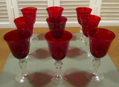 On Ebay  \ MixhWLK5060 Nine (9) Red Glass/Clear Stem Goblets – Great for Holiday Table Settings