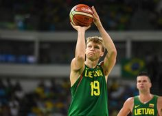 Rio 2016 Olympics - Basketball --  Aug 7, 2016; Rio de Janeiro, Brazil; Lithuania small forward Mindaugas Kuzminskas (19) shoots a free throw against Brazil in a mens preliminary basketball game at Carioca Arena 1 during the 2016  (850×615)