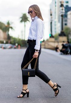 Aussie blogger and editor of Base Colour, Holly Titheridge, has got workwear down. Reach for your fave black trousers, roll up the hems and then tuck in a white shirt. Layer your cuffs with a gold watch and bangle and finish with a pair of stacked-heel sandals <3
