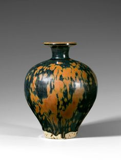 A rust splashed black-glazed ovoid bottle-vase, Song dynasty, (AD 960-1279)