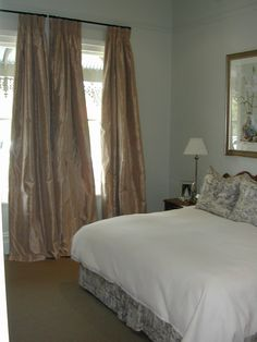 Full silk curtains on metal rods- by Candlewick Interior decorators Melbourne