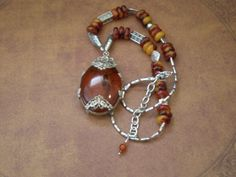 Baltic amber beads, sterling silver, and a scorpion in Amber colored resin.  (2 of 2)