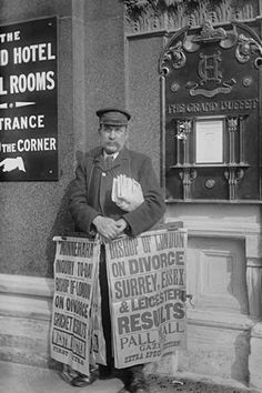 Newspaper salesman in front of Buffet Restaurant in Central London advertises News Headlines