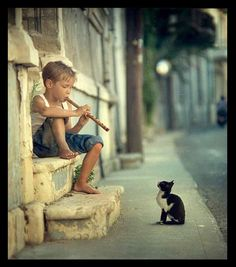 Cat Charmer Boy Playing Flute