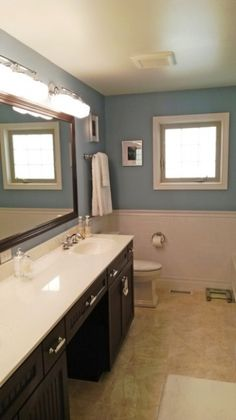 Bold paint choice makes master bathroom pop with color