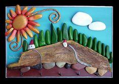 lavoro su commissione  Quadretto con paesaggio toscano realizzato mediante assemblaggio di sassi dipinti e legno, con l'aggiunta di ganci metallici ...