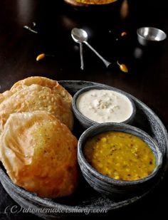 Hing er Kochuri ar Mishti dokaner Cholar Daal (Asafoetida flavoured stuffed Indian fried bread and Bengal gram curry with potatoes)