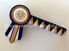 Navy velvet, midnight navy velvet, deep honey gold and white satin sharkstooth show browband pictured detailed with Swarovski crystals and angled pointed flags  www.silverburnbrowbands.co.uk