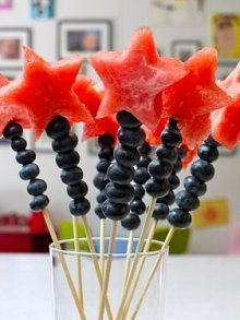 Watermelon cut into shapes...so fun.  Could also duplicate this idea with grapes instead of blueberries.