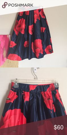 Floral skirt Beautiful red and navy floral skirt. Elastic waistband in back with side zipper. Skirts A-Line or Full