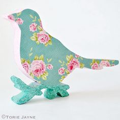 Glittered floral print Christmas bird by Torie Jayne