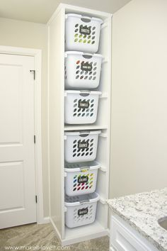 perfect for in closet to hold tubs so you can take out one without moving them all DIY Laundry Basket Organizer (...Built In) | Make It and Love It
