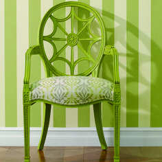 A green Cristal Chair paired with green striped walls...We're green with envy!
