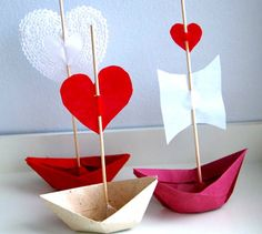 we could do these for place cards or add wooden skewer sticks and papers for names to the paper cranes :)