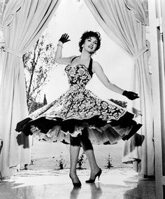 Gina Lollobrigida twirling around in a gorgeous halter dress 50s photo print ad movie star full skirt floral print