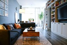 """First up? Designer Amanda Gorski replaced the all-white floors with new oak flooring from LV Wood and installed a larger baseboard. """"I wanted something elegant with a slight touch of rustic, but not too dark,"""" she said. """"This has a warm, grayish-brown, almost mushroom color to it, that accomplishes the job perfectly."""""""