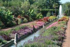 The Canal Garden, in Charlotte, is about 100 yards long with water features surrounded by fountains on both ends. Explore it on Wheretraveler.com  #wheretraveler #charlotte