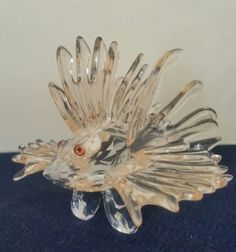 "The fins are a very light peach or shrimp color. This Beautiful Swarovski Crystal Lion Fish. No box or COA. The while the body is crystal clear color. Measure approx. 2 5/8"" long. Excellent Condition. 