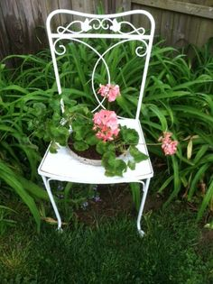 Chair recovered from trash.  Took off the seat covering, spray paint, cut a hole in the plywood base, add a flower pot, and great flower bed addition.
