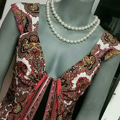 Maggi London ~10~Dress Rich paisley like design in red black bits of yellow and white  95%polyester 5 % spandex  Very good condition  Moves beatifully Maggy London Dresses
