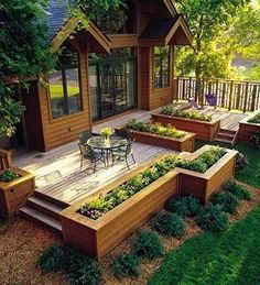 Patio with wood, wrap around with wood and then use a berm and landscape around to blend the incline into the yard.