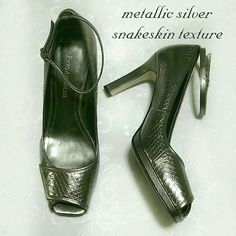 $13 if bundl! Metallic snakeskin ankle strap heels Perfect texture for the fall season! Metallic dark silver color. Snakeskin/croc texture. Leather. Beautiful design with peep toe & adjustable ankle strap.   In good condition with only minimal signs of wear. Back of one shoe has a small black mark (pen?) which isn't noticeable while wearing, since they are metallic. The other heel has slight scuff on the edge, as shown. Reflected in price.   More beautiful in person! You'll get compliments…