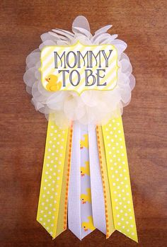 This pin is perfect for any baby shower addition! Can be pinned to any piece of clothing! Ivory flower corsage pin with Choose one: Mommy Mommy