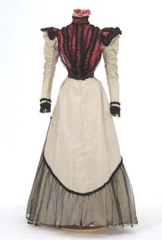 Gray and pink taffeta dress trimmed with black net. Attributed to dressmaker Mary G. Worley, St. Paul, Minnesota.
