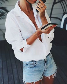 white linen top and cutoff shorts