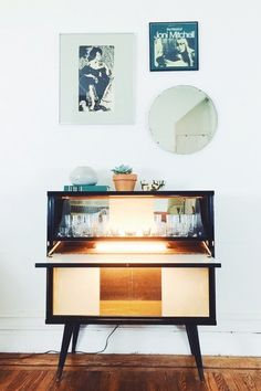 The bar is in great condition. The light goes on and off when the door is opened and closed. The cabinet comes with the original, etched bar glasses, and includes 6 highball glasses, 5 tumblers. Diy Home Bar, Bars For Home, Bar Furniture, Furniture Design, Furniture Projects, Mid Century Bar, Bar Cart Decor, Mid Century Furniture, Liquor Cabinet