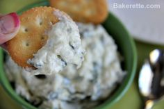 Cold Spinach and Artichoke Dip on a cracker. Bakerette.com