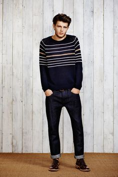 I'm not sold on the jean rolled so high...but I like the dark wash, striped sweater and classic shoe.