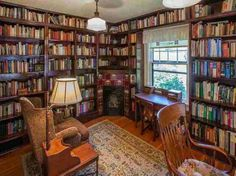 Love the corner fireplace in this little library.