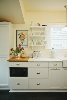 mixed countertop materials - butcher block to cut on; marble to put hot things down on. functional and pretty.