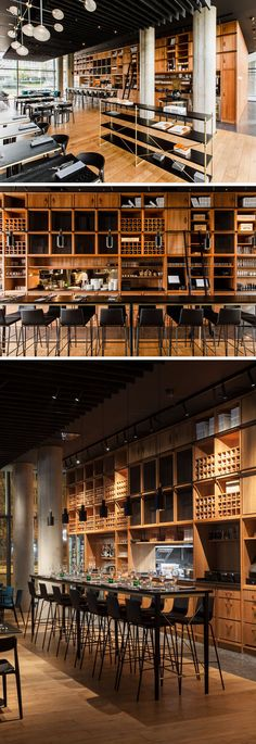 The dining room of this modern restaurant features a large floor-to-ceiling wood shelving unit that measures in at almost 14-meters-long. #RestaurantDesign #Shelving