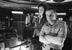 """Yaphet Kotto, Sigourney Weaver and Ian Holm 'Alien'  by Terry O'Neill  From left to right, actors Yaphet Kotto, Sigourney Weaver and Ian Holm on the set of Ridley Scott's science fiction classic 'Alien', circa 1979.  Limited Edition Silver Gelatin Signed and Numbered  12"""" x 16"""" / 16"""" x 20""""  20"""" x 24"""" / 20"""" x 30""""  24"""" x 34"""" / 30"""" x 40""""  40"""" x 60"""" / 48"""" x 72""""  For questions or prices please contact us at info@igifa.com   IGI FINE ART"""