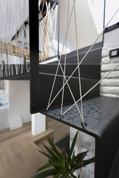 Attic Loft Reconstruction by B² Architecture #wire #railing