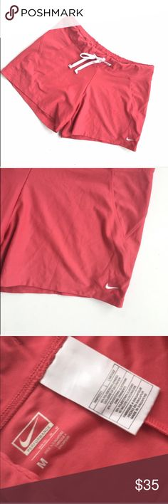 """Nike coral/pink drawstring shorts Drawstring shorts. Coral/pink color. Gently used. Lots of pictures uploaded for your viewing pleasure. Ask questions before buying Due to surgery and not being able to workout I'm thinning my collection of workout clothing. Size medium. Drawstring. RISE = 10 INSEAM = 5 Waist laying flat = 15 1/2"""" with 2"""" stretch. compare to your own shorts for proper fitting purposes.  No pockets. KKZ  🌹no trades 🌹discounts on bundles of 2+  🌹1000 items listed, take a…"""