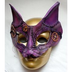 Purple Leather Steampunk Cosplay Cat Mask ❤ liked on Polyvore featuring costumes, leather halloween costumes, steampunk halloween costume, purple halloween costumes, cosplay costumes and steam punk halloween costumes