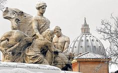 Rome in winter: St Peter's Basilica with a coating of snow