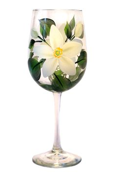 Large white petals with bright yellow centers and deep green leaves hand-painted on quality 18.5 ounce wine glass.
