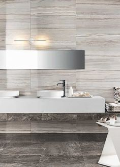 """3 different colors and available in 12""""x24"""" Tile sizes. Polished and shiny. When space is reflected in mirror-finish surfaces, everything comes to life. Impronta, Italgraniti.   Available to order directly from BV Tile & Stone. Contact us today (714) 772-7020 or visit our website www.bvtileandstone.com Retail and Wholesale.To compliment any bathroom, kitchen, bedroom, or living room. For interior or exterior applications. Ceramic, Porcelain, Travertine, Marble, and Mosaic Floor and Wall…"""
