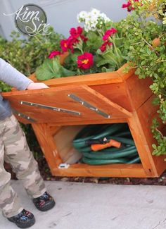 Hide away that ugly garden hose with this gorgeous planter with hidden storage!